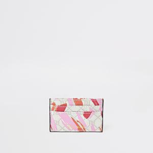 Roze RI kaarthouder met lipstickvlek