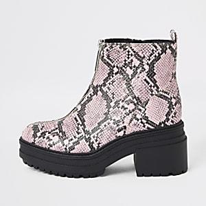 Grobe rosa Stiefel mit Reißverschluss in Schlangenlederoptik