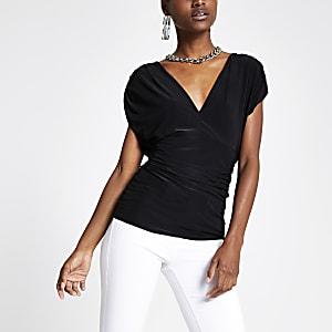 Zwarte aansluitende top met V-hals en strik op de rug