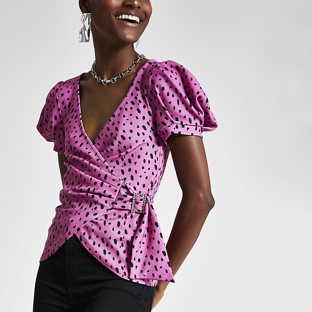 Pink print wrap embellished buckle wrap top