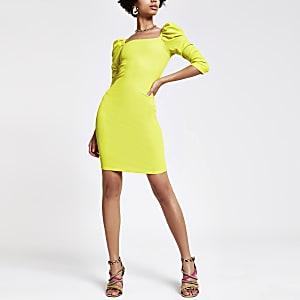 Robe près du corps vert citron à manches bouffantes