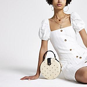 Crème mini-jurk met pofmouwen en knopen voor