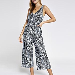 Blauwe plissé jumpsuit met zebraprint