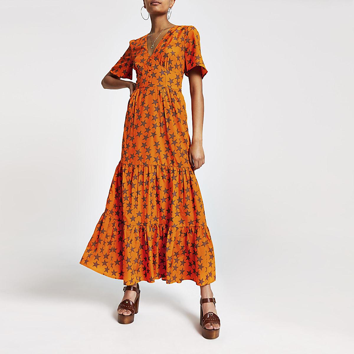 Oranje maxi-jurk met sterrenprint en knoopsluiting voor