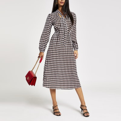 Black Dogtooth Tie Neck Waisted Midi Dress by River Island