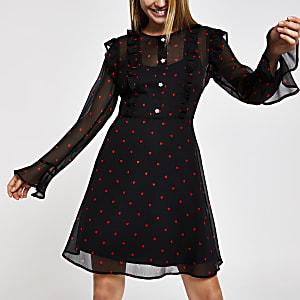 Mini-robe noire transparente imprimé cœurs
