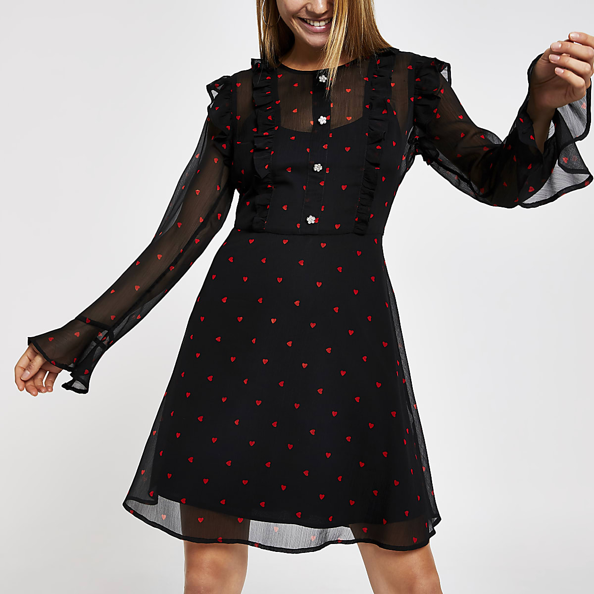 Black heart print sheer mini dress
