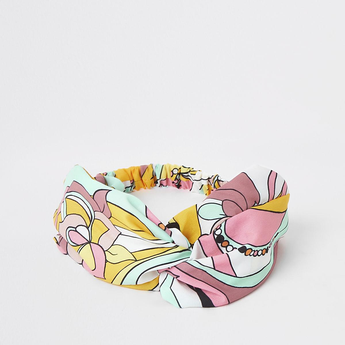 Pink swirl print twist front headband