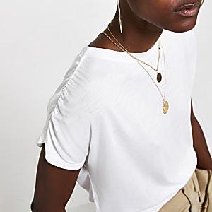 Wit T-shirt met ruches aan de mouwen