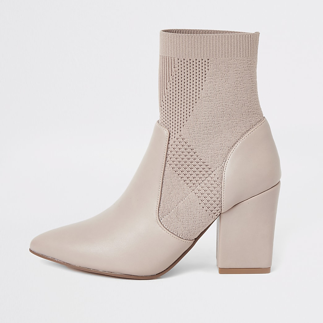 Light pink knitted heeled sock boot