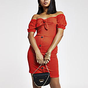 Petite red bardot knot front mini dress