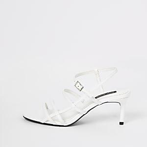 White caged skinny heel sandals