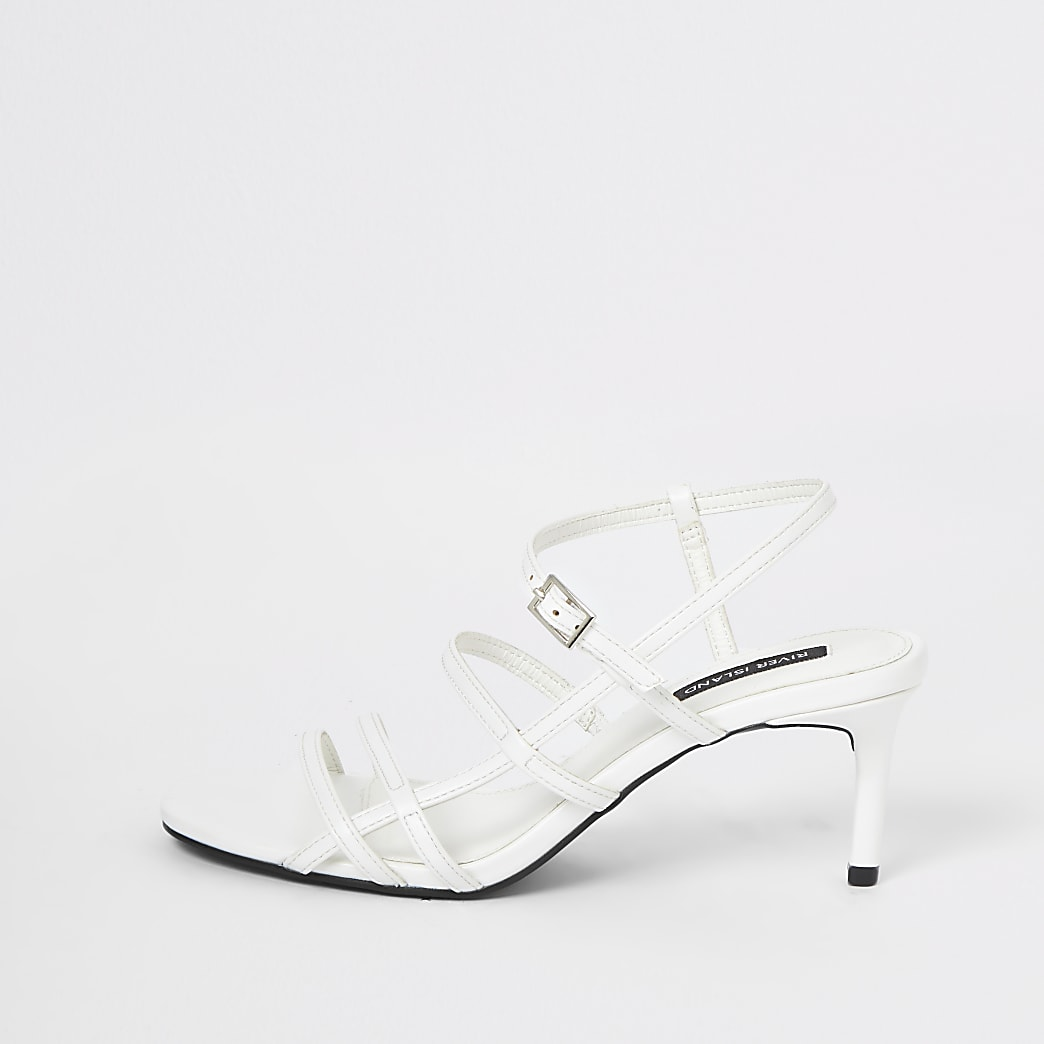 White caged skinny heel sandals