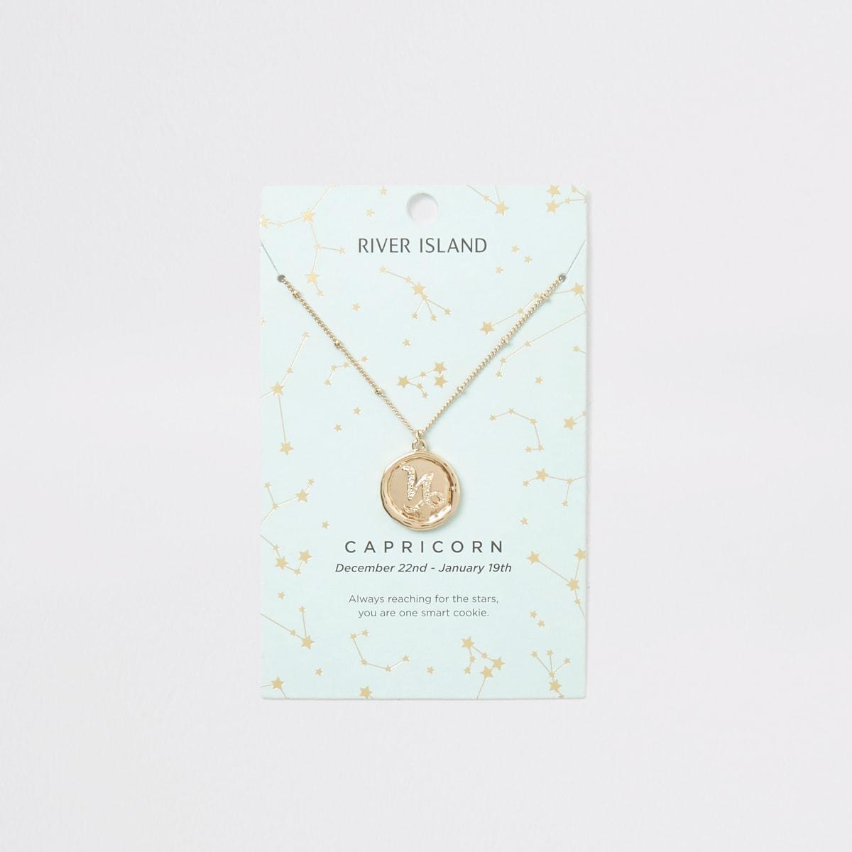 Collier doré avec signe du zodiaque capricorne