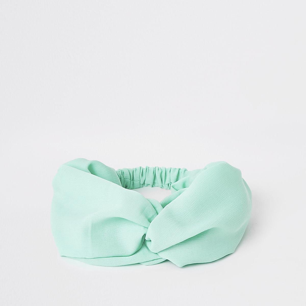 Blauwe brede gedraaide hoofdband