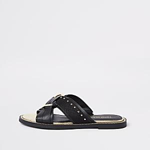 Sandales noires style mule à brides croisées cloutées coupe large