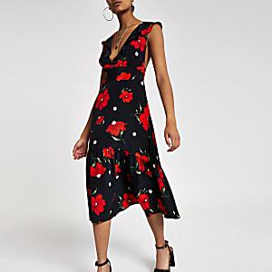 Zwarte midi-jurk met ruches aan de zoom en bloemenprint