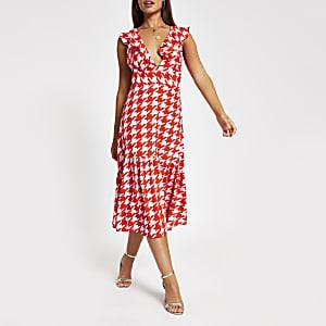 Roze midi-jurk met ruches langs de zoom en print