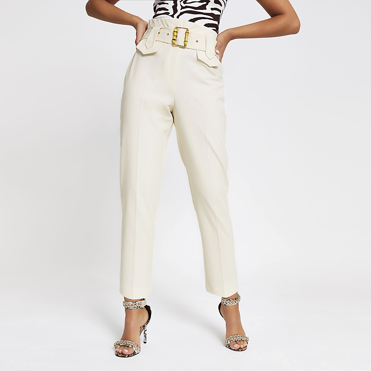 Cream buckled waist tapered trousers