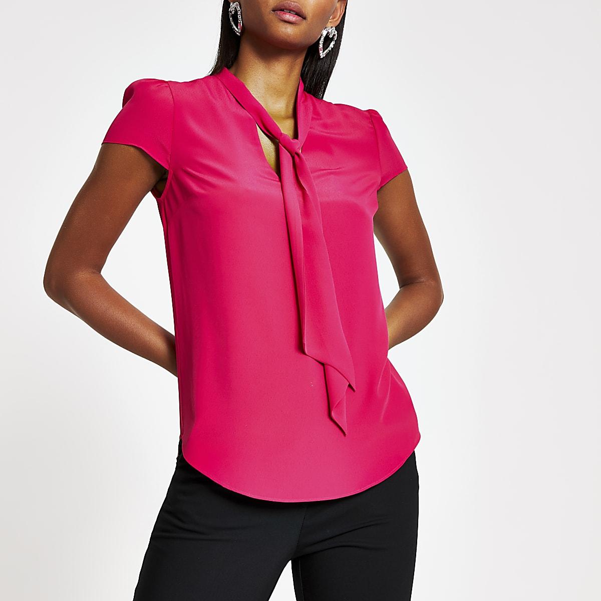 Roze blouse met strik bij de hals