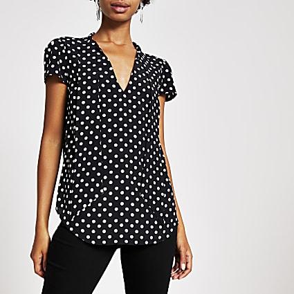 Black polka dot tie neck blouse
