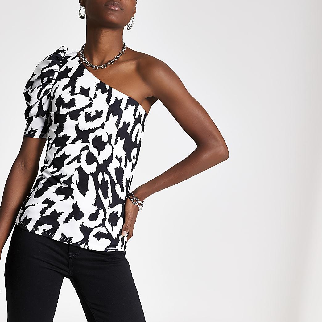 Zwarte top met blote schouder en print