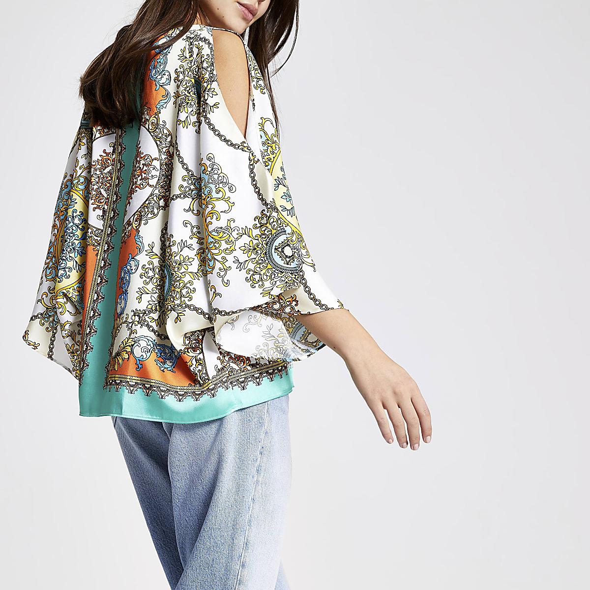 Turquoise capetop met sjaalprint