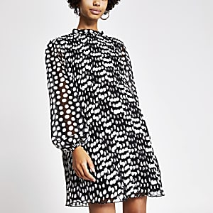 White polka dot pleated swing dress