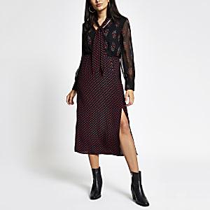 Zwarte midi-jurk met paisleyprint en strik bij de hals