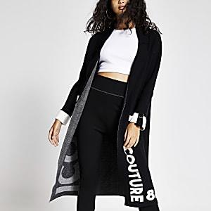 Schwarze, kultige Duster-Jacke aus Strick in Longline-Silhouette