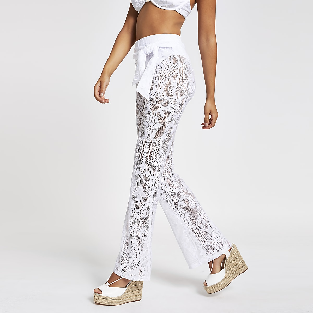 White lace flared tie waist trousers