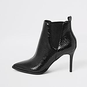 Zwarte lakleren laarzen met puntige neus en brede pasvorm
