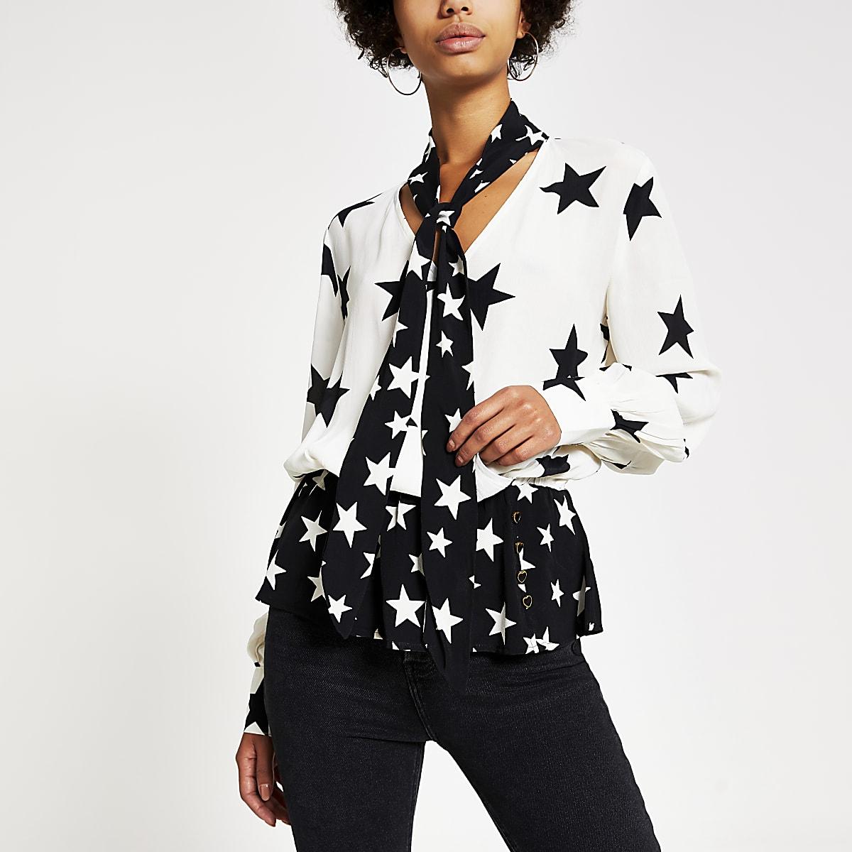 Crèmekleurige blouse met sterrenprint en strik bij de hals