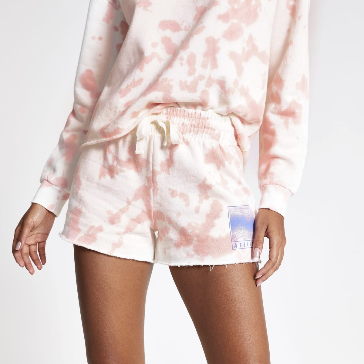 Pink tie dye runner shorts