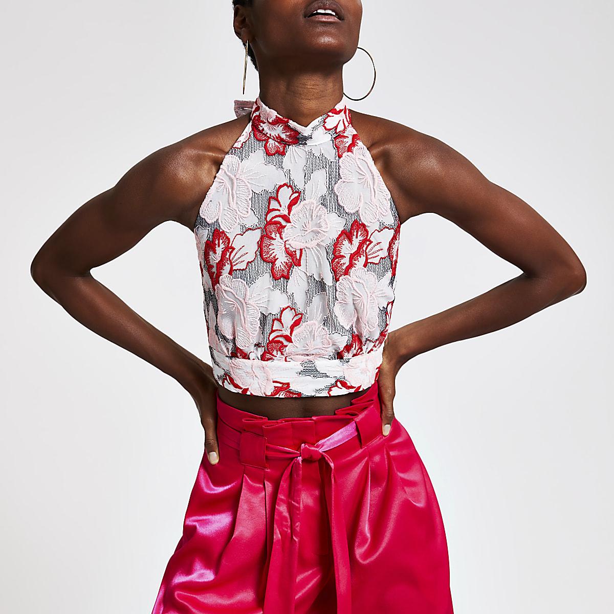 Roze top met halternek, print en strik op de rug
