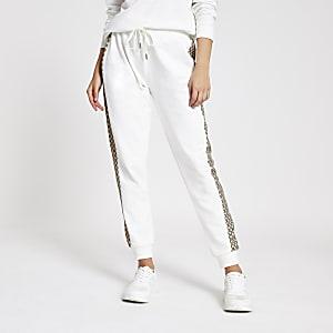 Pantalon de jogging crème avec monogramme RI