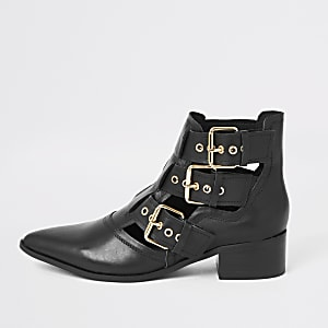 Black leather cut out buckle ankle boots