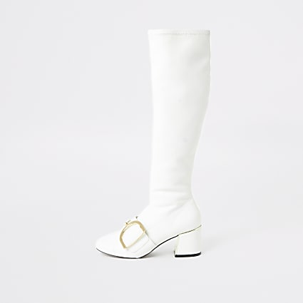 White buckle strap knee length boots