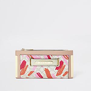 Beige portemonnee met RI-monogram en lipstickvlekken