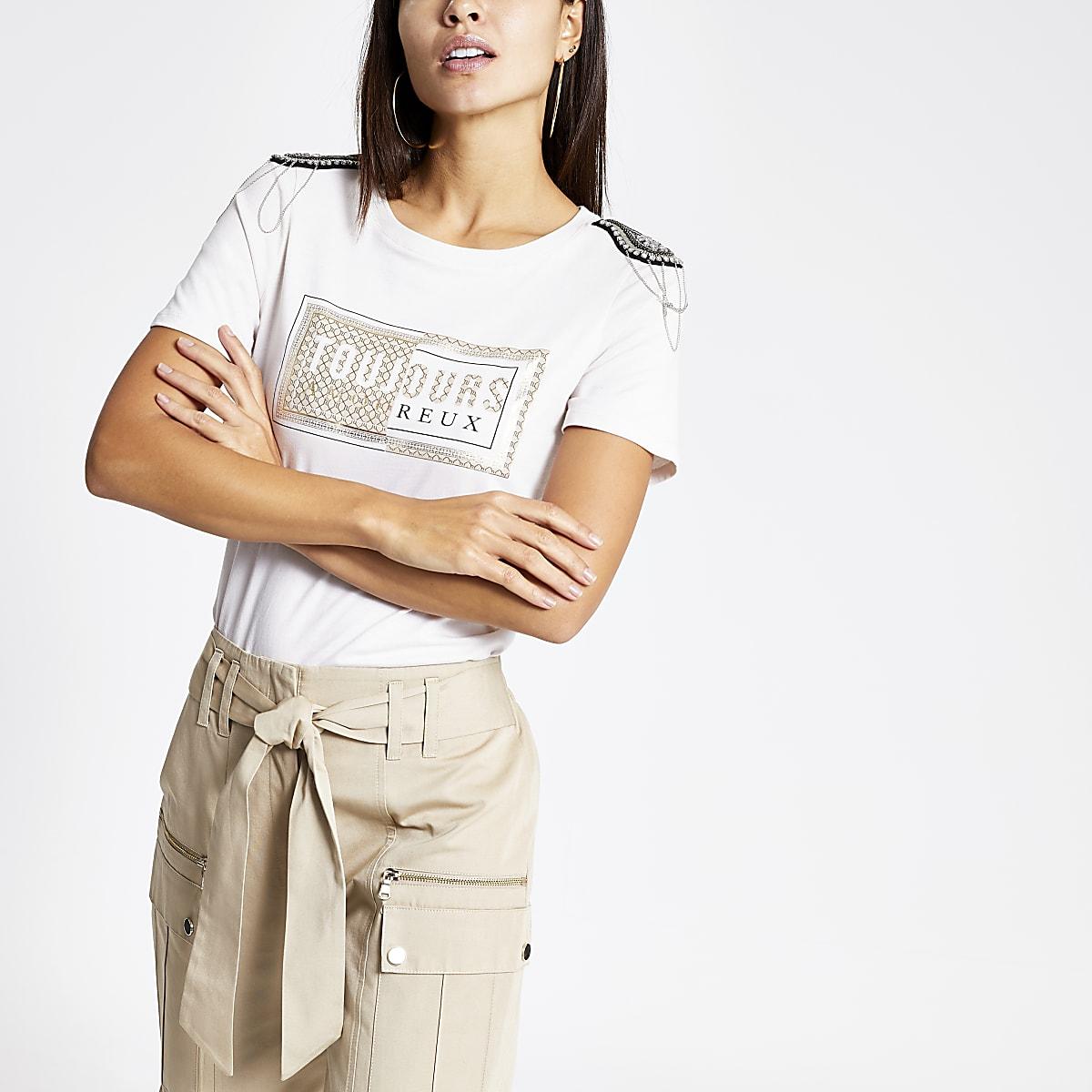 Crème T-shirt met print en verfraaiing op de schouder