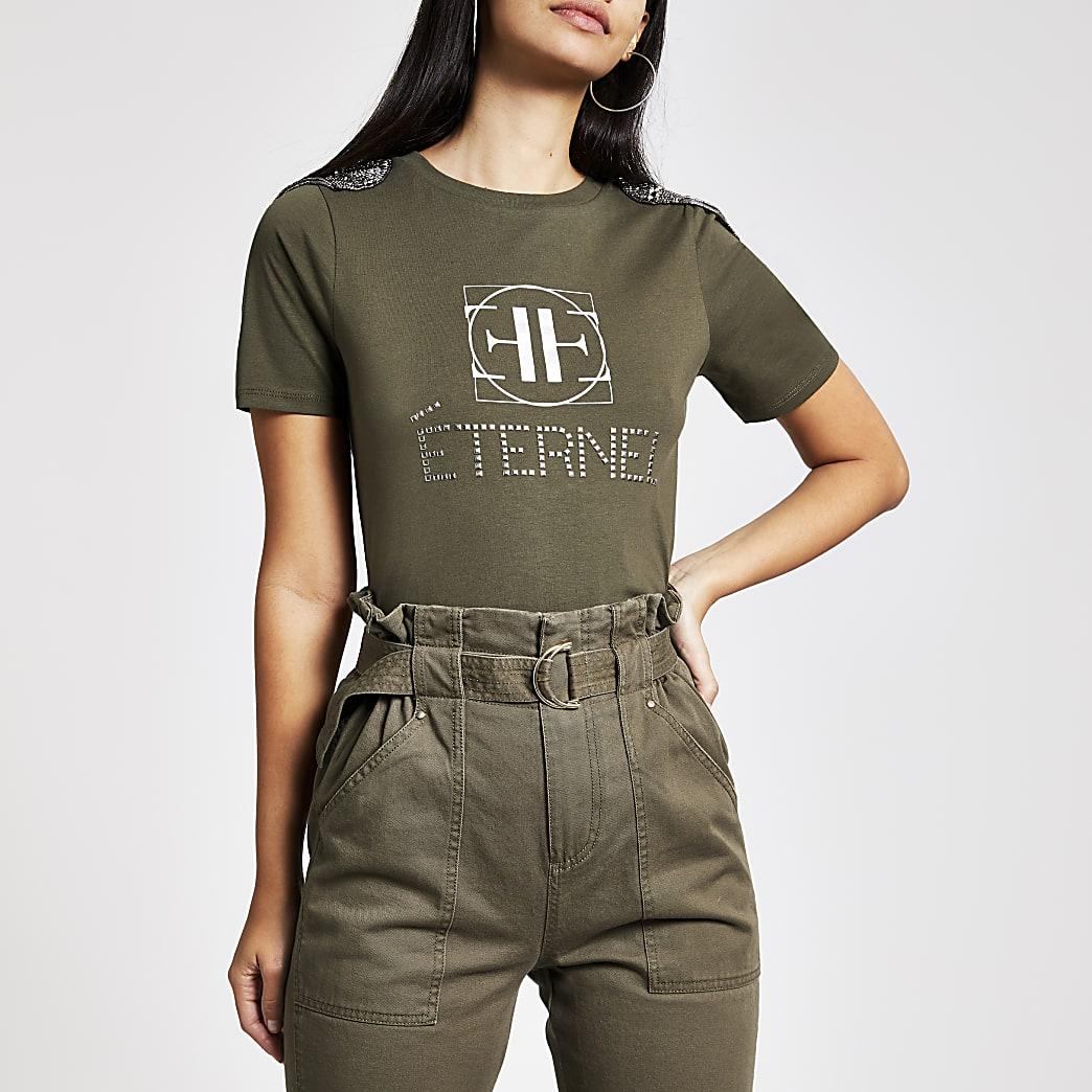Kaki T-shirt met versiering op de schouder