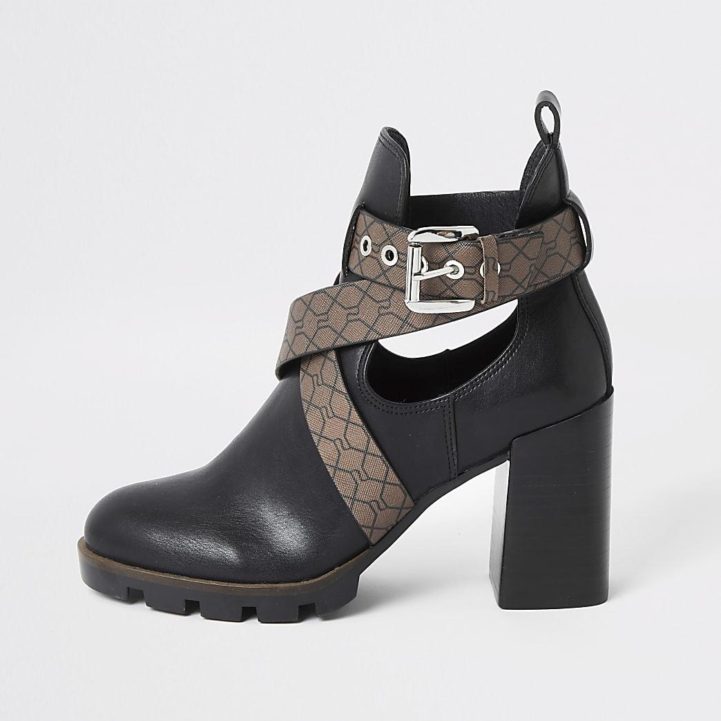 Zwarte laarzen met hak, bandjes, RI-reliëf en uitsnijding