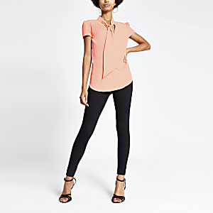 Coral tie neck short sleeve blouse