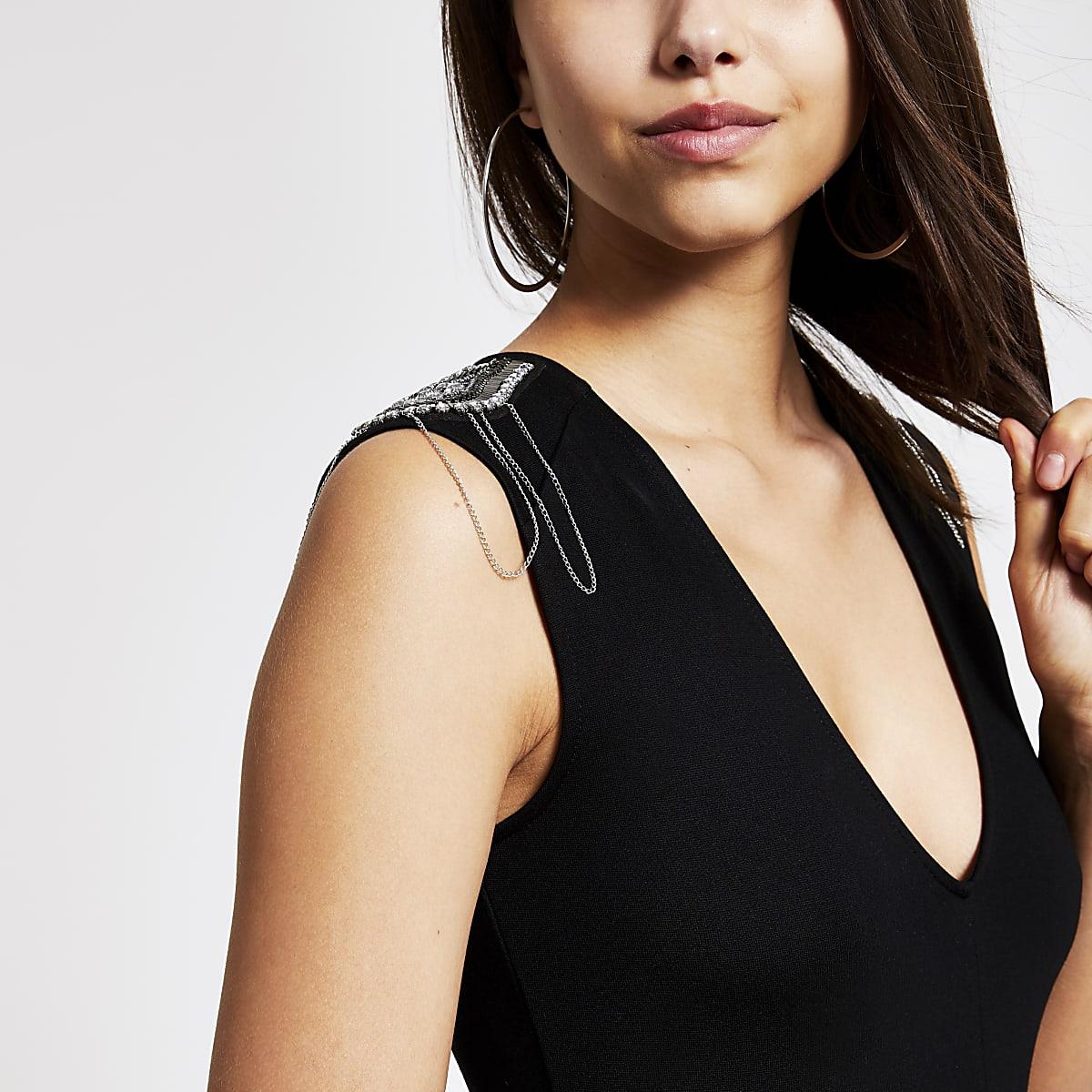 Zwarte bodysuit met versierde schouder