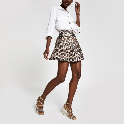 Beige Ri Print Pleated Mini Skirt by River Island