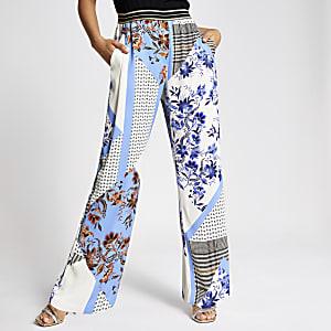 Blauwe broek met print, elastische taille en wijde pijpen