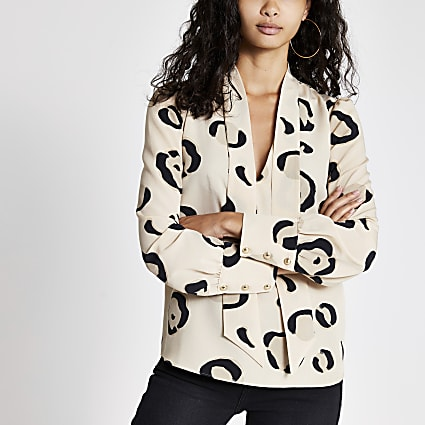 Cream leopard print tie neck blouse