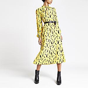 Robe mi-longue imprimée jaune avec liens au col