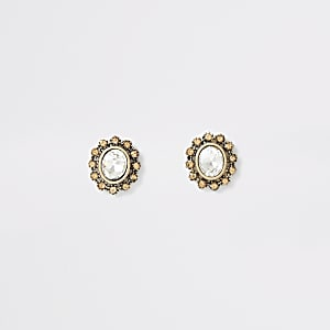 Goudkleurige oorknopjes met ovalen kristal en studs