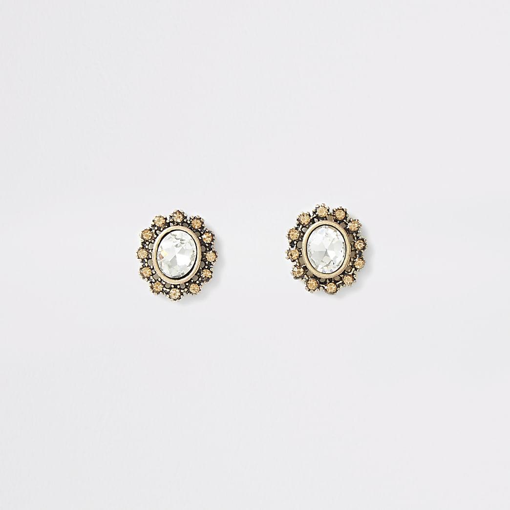 Boucles d'oreilles dorées ovales ornées de cristal